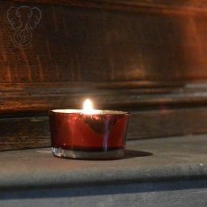 Burning candle at St Katharines's Parmoor, Buckinghamshire, England (Miranda Hernandez)