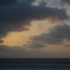 Dark and moody sunset over the ocean in Kaua'i, Hawai'i (Miranda Hernandez)