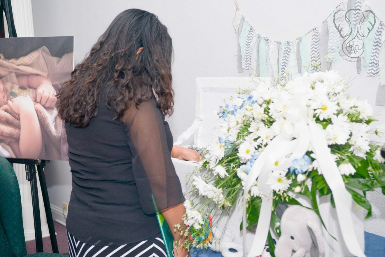 Miranda with Adrian's casket (Modern Lux Photography)