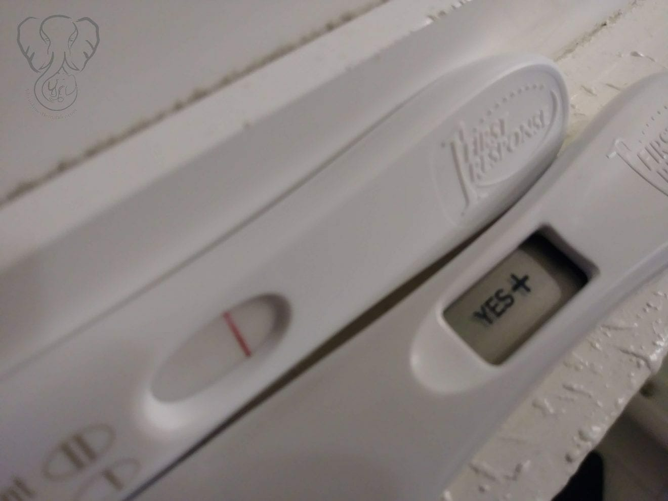 """Close up of two positive pregnancy tests against a white shelf. One test is an ink test, and the other is digital. The digital test says """"Yes+""""(Miranda Hernandez)"""
