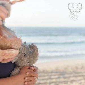 Miranda with Adrian's Elephant during Adrian's Memorial on the California coast (@saltwaterandclay)