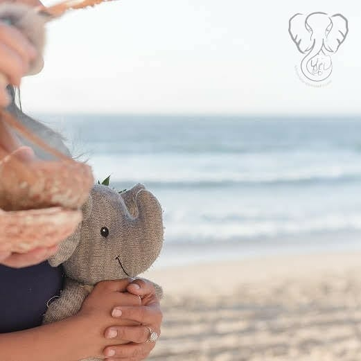 Miranda with Adrian's Elephant during Adrian's Memorial on the California coast (@saltwaterandclay)