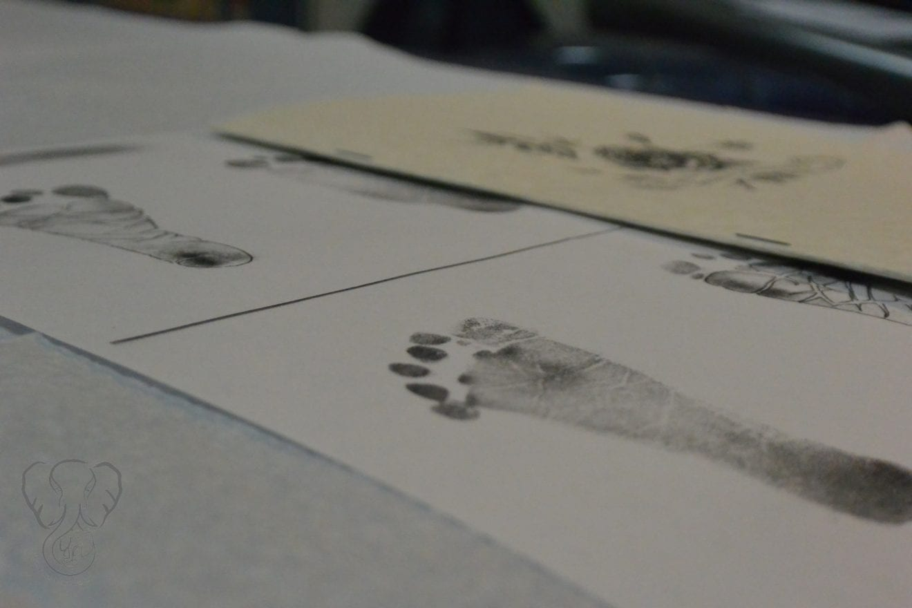 Close up of Adrian's footprints on a table. The footprints were used as templates to create the tattoo (Miranda Hernandez)
