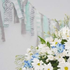 Daisies and Bluebonnets on Adrian's casket(Modern Lux Photography)