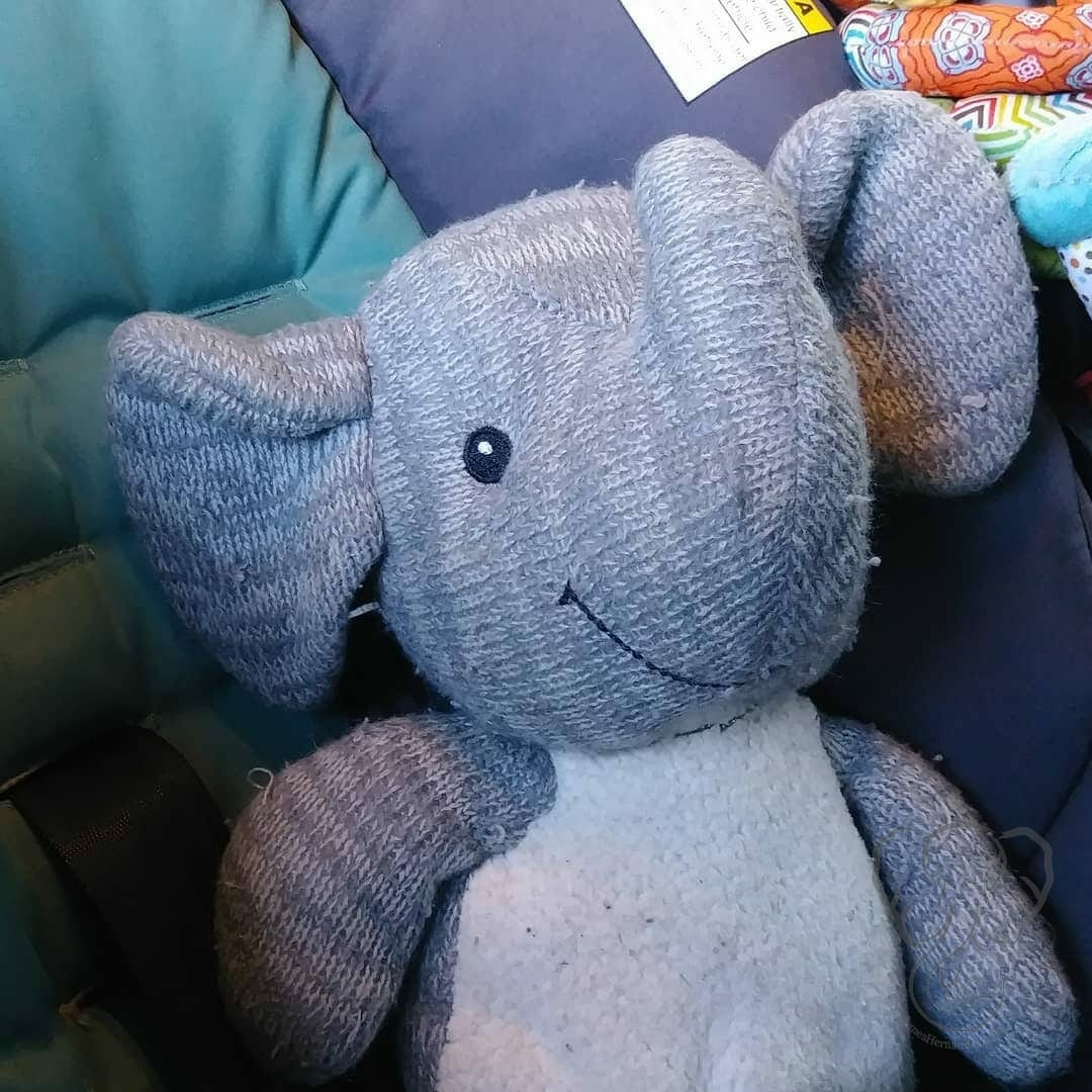 Adrian's Elephant in his and Peanut's car seat