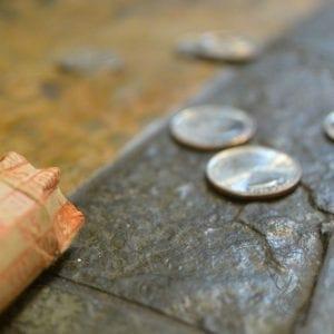 Quarters on tile (Miranda Hernandez)