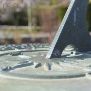 Close-up on weathered gray sundial in the Hatley Castle Gardens, Victoria, British Columbia (Miranda Hernandez)
