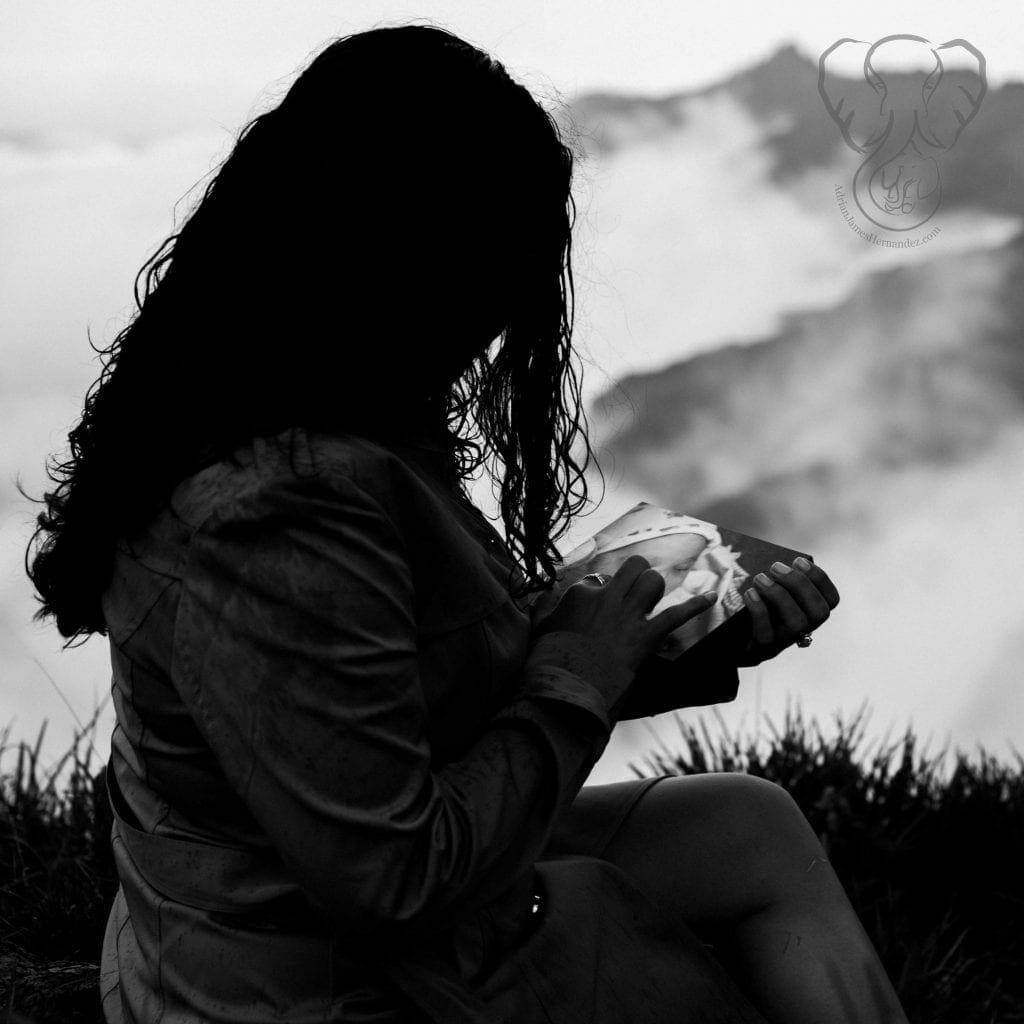 The Worst Part of Child Loss | Miranda holding Adrian's photo in the mountains of Kaua'i (Luna Kai Photography)