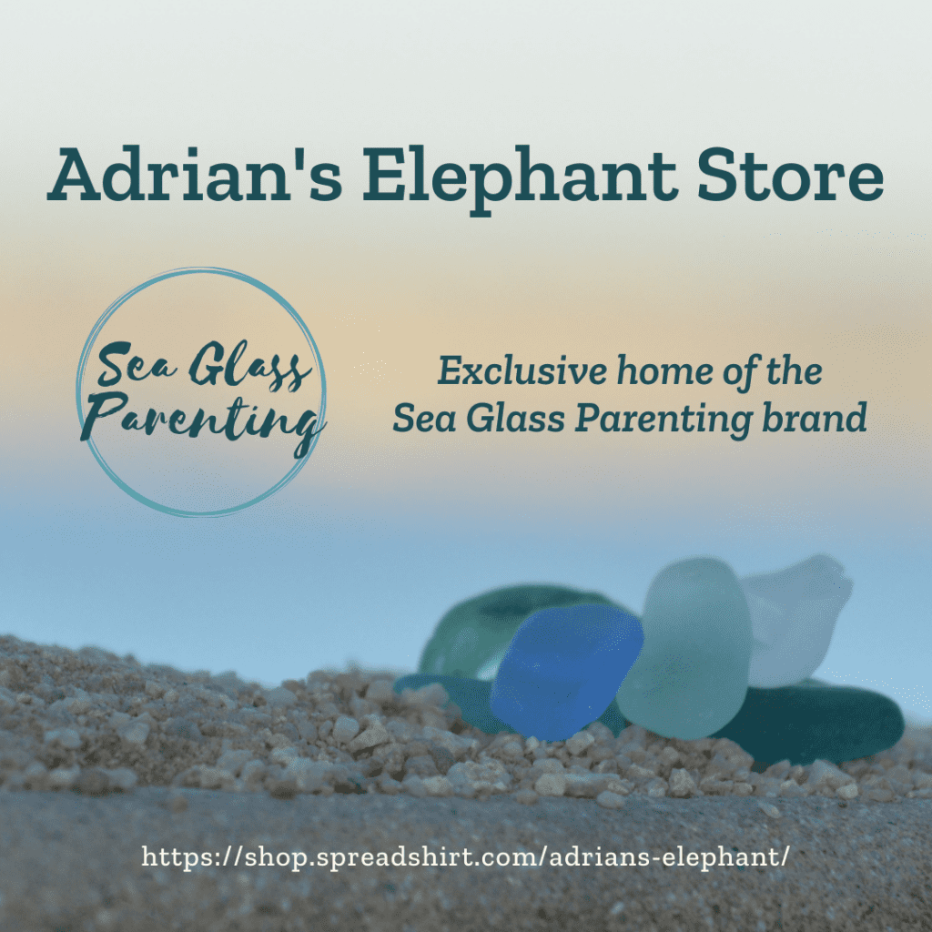 """Close-up of blue and green sea glass sitting on pebbly sand at sunset. The words """"Adrian's Elephant Store, Exclusive home of the Sea Glass Parenting Brand"""" are written above in dark green text. The address of the Spreadshirt shop is written below in white text: https://shop.spreadshirt.com/adrians-elephant/"""