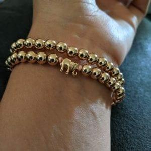 Miranda wearing her bracelets with an elephant charm.