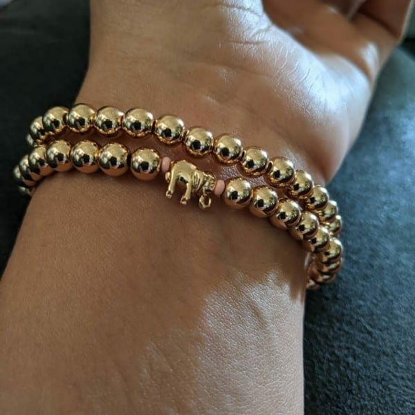 Miranda wearing her bracelets with an elephant charm.