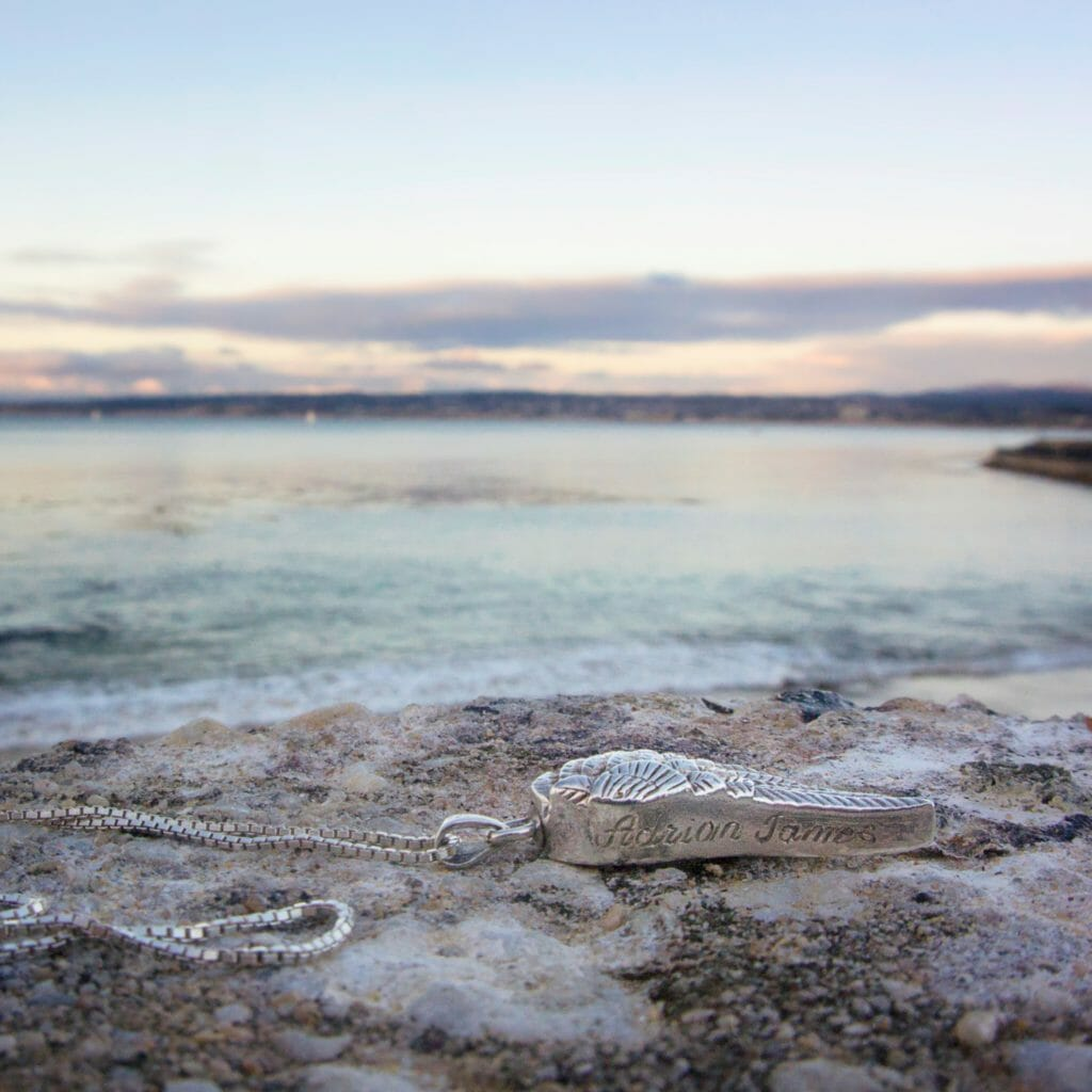 Adrian's necklace on the California coast at sunset (Miranda Hernandez)