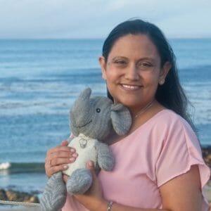 Miranda holding Adrian's elephant on the coast in California.