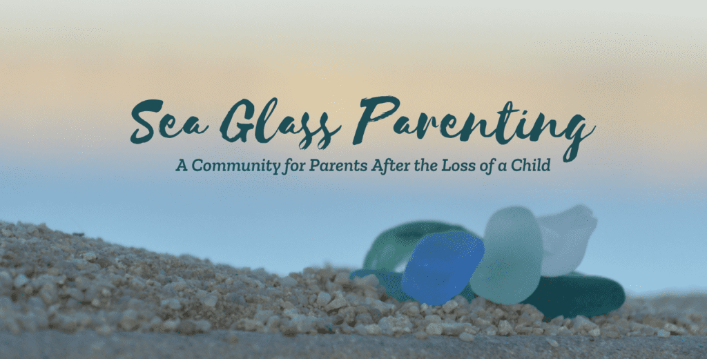 """Close up view of blue and green sea glass sitting on pebbly sand at sunset. The words, """"Sea Glass Parenting, A Community for Parents After the Loss of a Child"""" are written at the top in dark green text."""