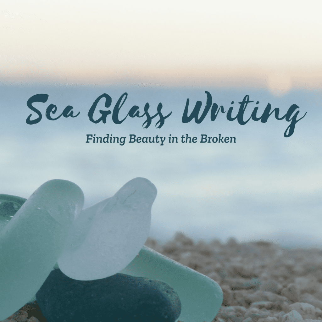"""Close-up of blue and green sea glass sitting on pebbly sand at sunset. The words """"Sea Glass Writing, Finding Beauty in the Broken"""" are written above in dark green text."""